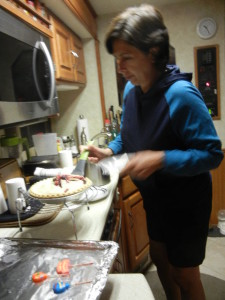 Therese serving the Birthday Berry Pie.