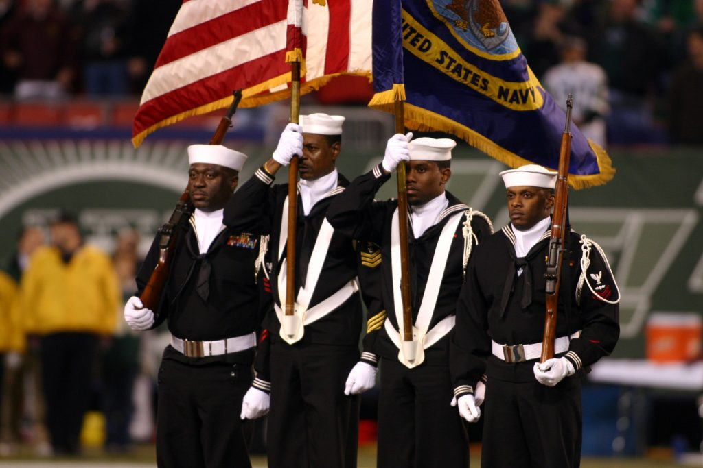 041101-N-0000X-001 East Rutherford, N.J. (Nov. 1, 2004) Ð A U.S. Navy color guard assigned to Naval Reserve Center Bronx, New York, parade the colors during the opening ceremony for Monday NightÕs Football game between the New York Jets and Miami Dolphins, at the Meadowlands Sports Complex. From left, MachinistÕs Mate 1st Class Jason Maynard, Operations Specialist 1st Class Michael Allen, Personnelman Seaman Apprentice Michael A. Cowan and Aviation ElectricianÕs Mate 2nd Class Darris Dupree, Jr. U.S. Navy photo by Alexander H. Craver, III (RELEASED)